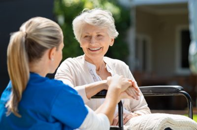 Smiling Senior Patient with Nurse