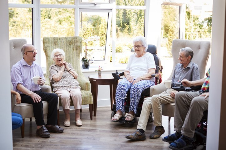 Seniors spending time in an adult day care facility receiving services including  long-term care