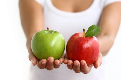 Woman holding an apple ineach hand