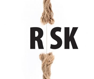 The word Risk on a thin rope