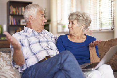 Senior marriage spreading their arms