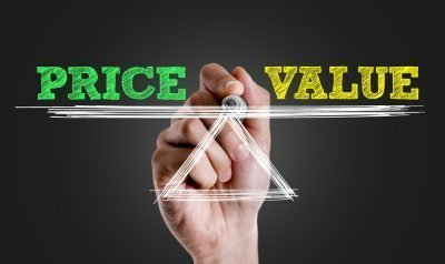 Hand writing the text: Price x Value